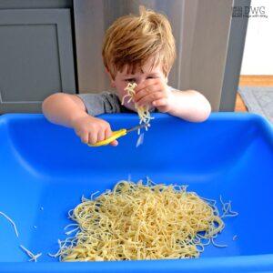 Scissor Skills Spaghetti Sensory Play