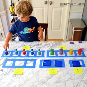 Tape, Toddlers, and Toys: A Toddler Counting Activity