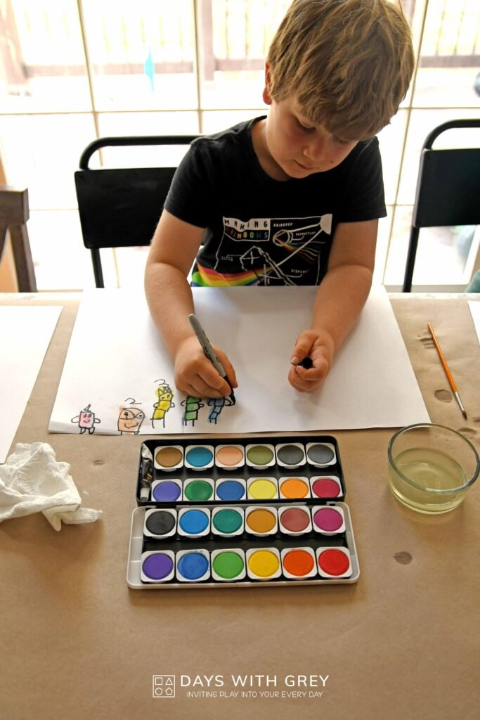preschooler using watercolors