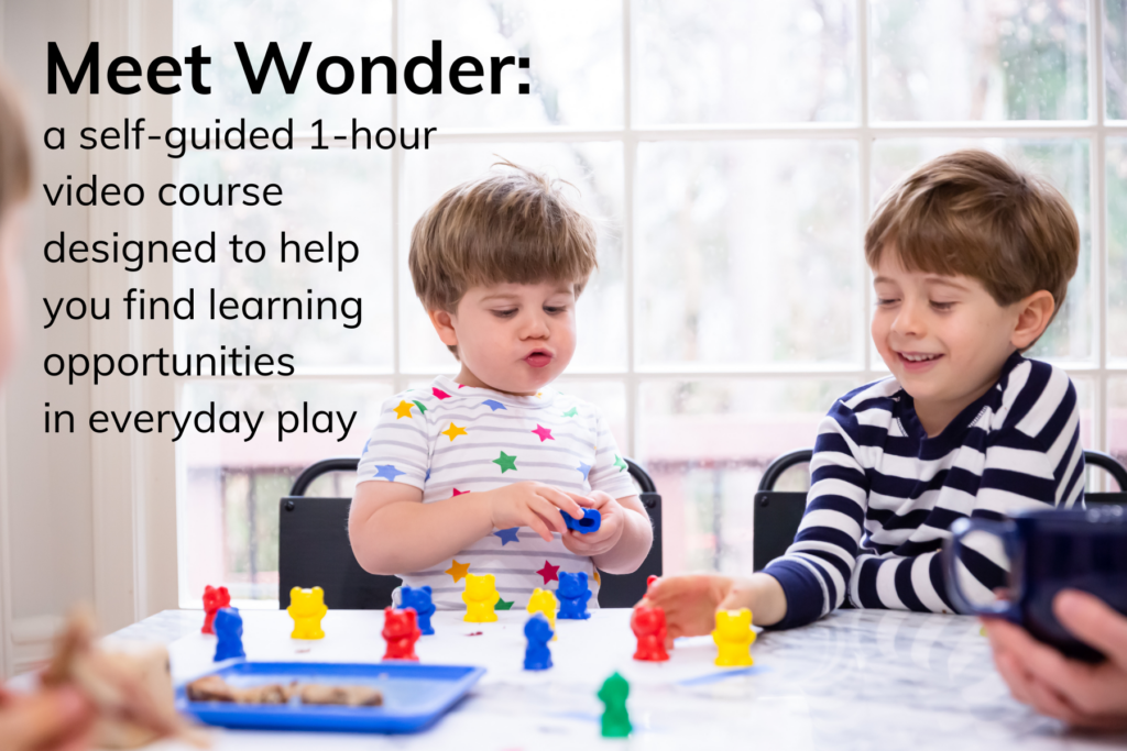two preschoolers playing a color sorting activity to learn through play